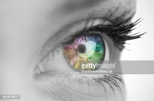Multi colored eye on grey face : Stock Photo