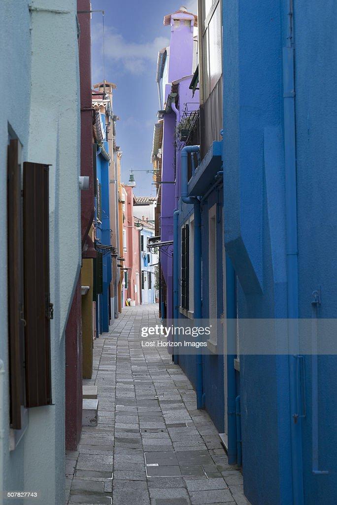 Multi colored houses in narrow alley, Burano, Venice, Veneto, Italy