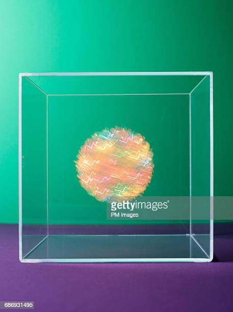 Multi colored orb in clear box