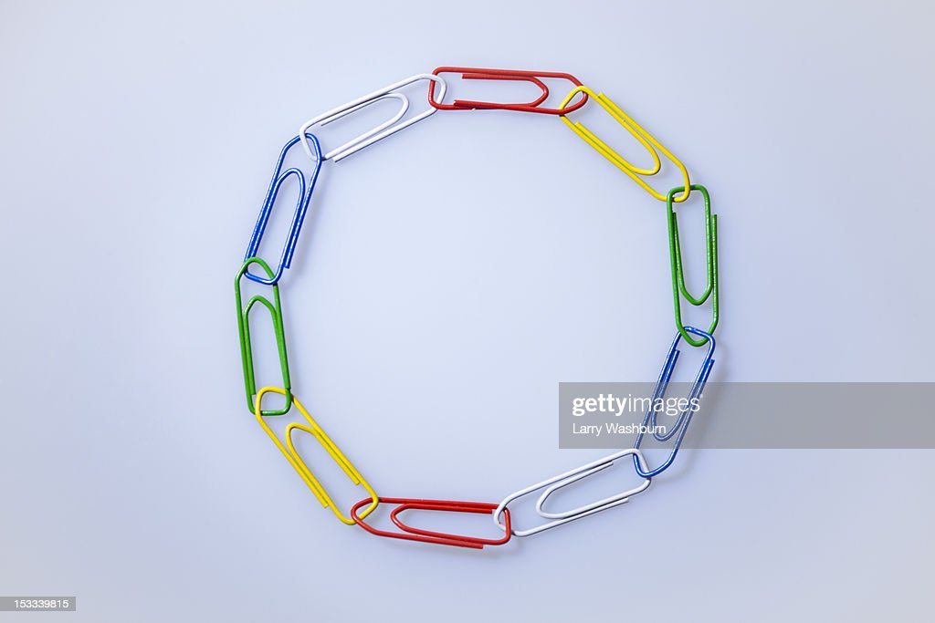 Multi colored paperclips arranged in a circle : Stock Photo