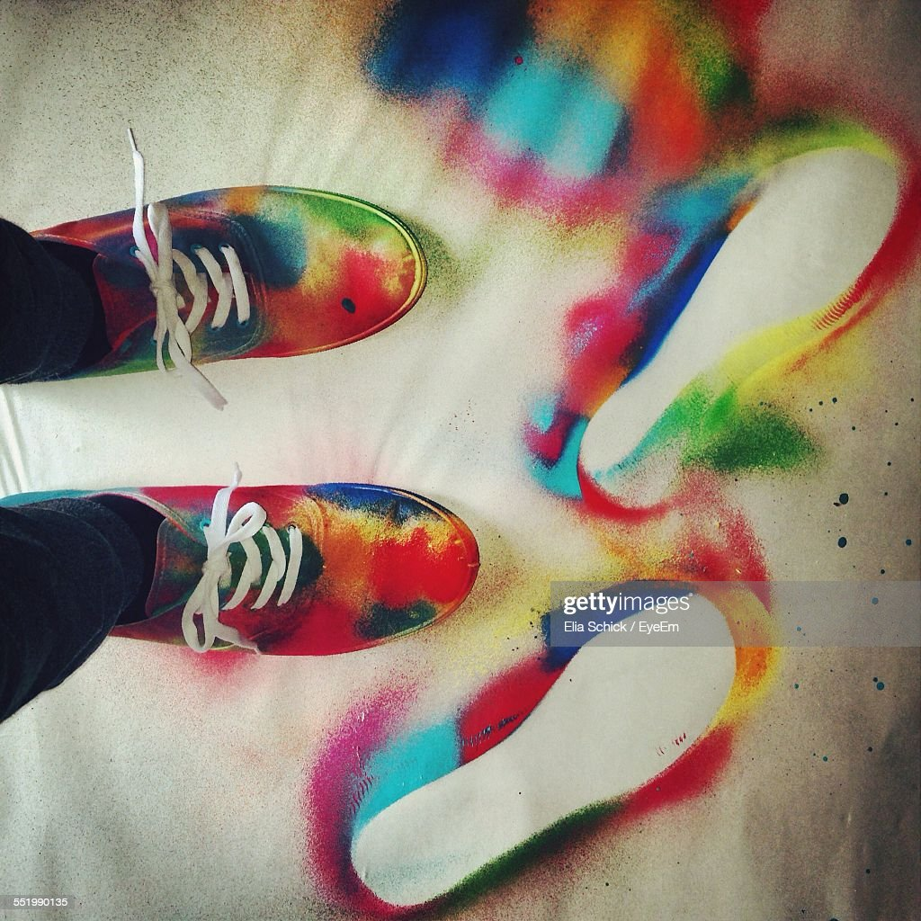 stock photo multi colored spray painted canvas shoes. Black Bedroom Furniture Sets. Home Design Ideas