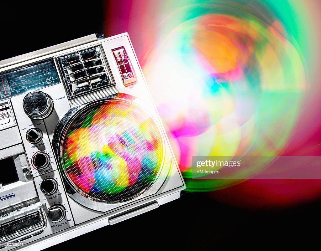 Multi colored waves from boom box : Stock Photo