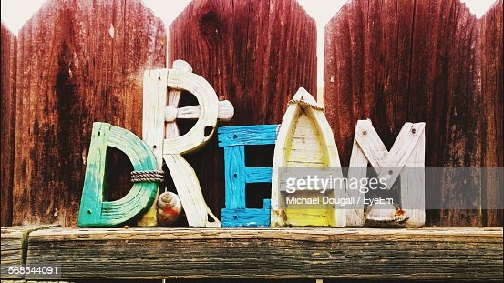 Multi Colored Wooden Text Against Fence