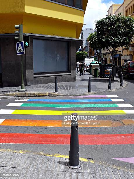 Multi Colored Zebra Crossing On City Street Against Building