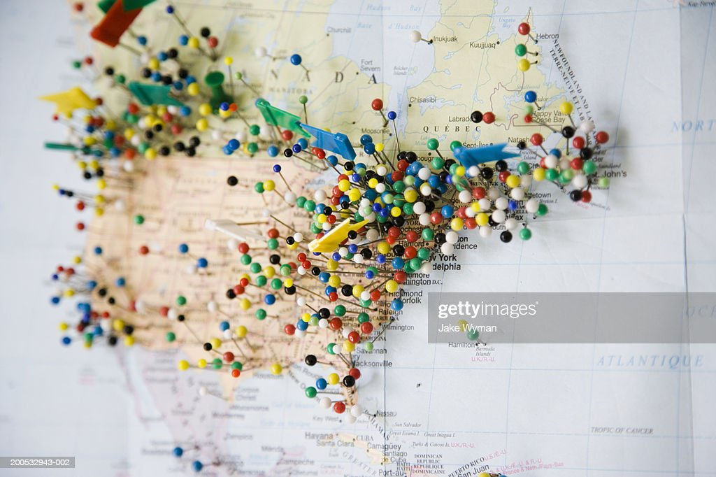 Multi coloured push pins in map, close-up : Stock Photo