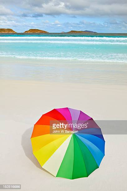 Multi coloured umberlla on a beach