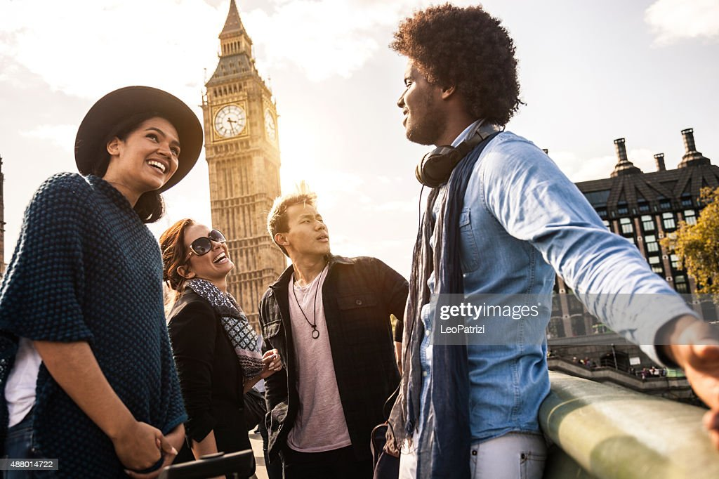 Multi cultural group of friends hanging out in Central London : Stock Photo
