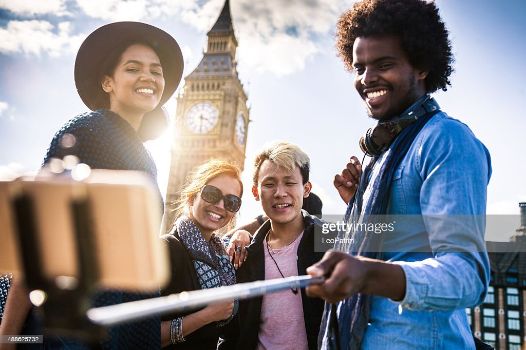 Multi cultural group of friends taking a selfie with BigBen : Stock Photo