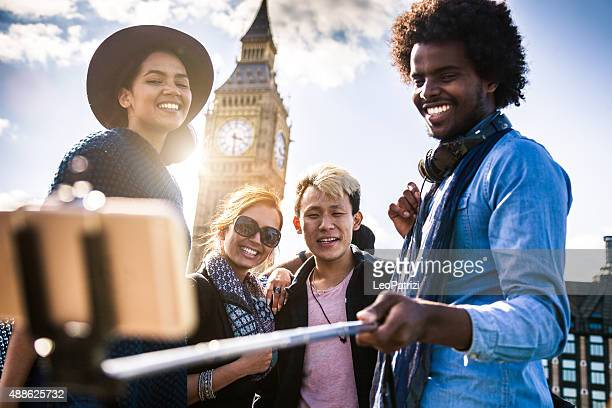 Multi cultural group of friends taking a selfie with BigBen