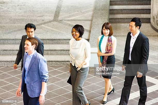Multi ethnic business team walking to meeting