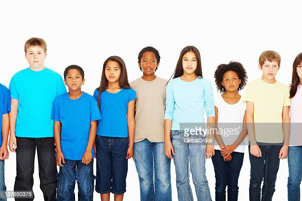 Multi ethnic children standing in a row against white background