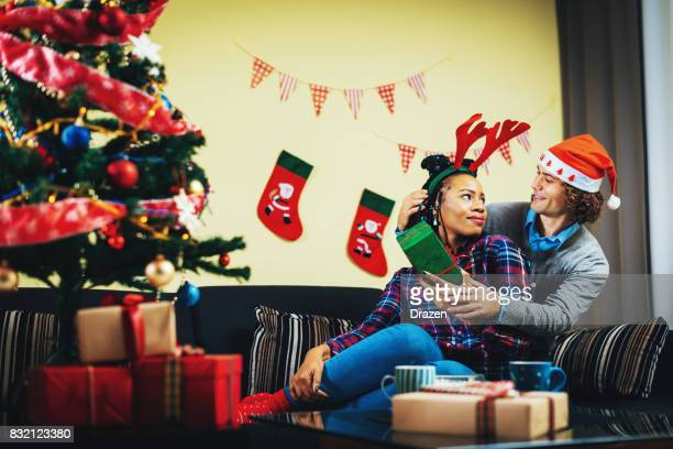 Multi ethnic couple in UK celebrating Christmas at home