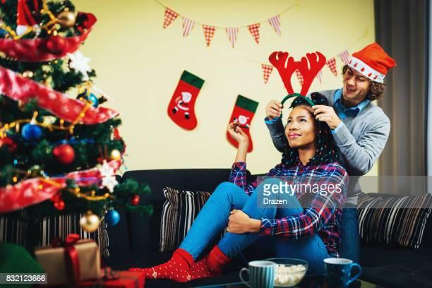 Multi ethnic couple in USA celebrating Christmas