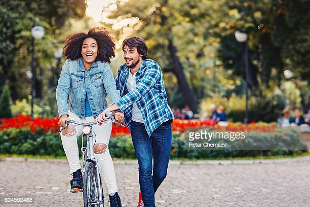 Multi ethnic couple with a bike