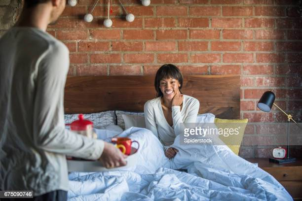 Multi Ethnic Couple with Breakfast in Bed