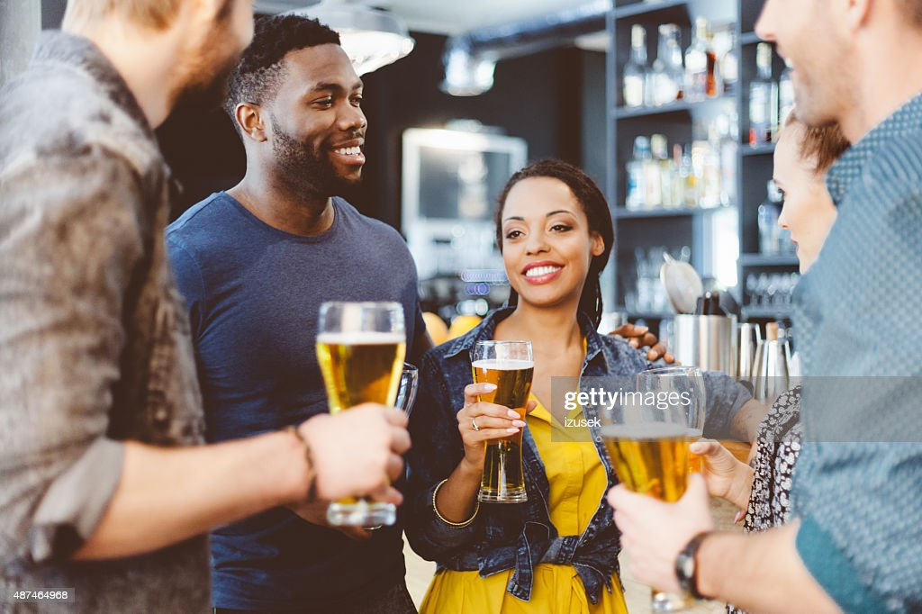 Multi ethnic friend having party in a pub