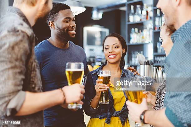 Multi ethnic friend having party in a pub