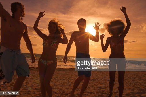 Multi ethnic friends at beach : Stock Photo