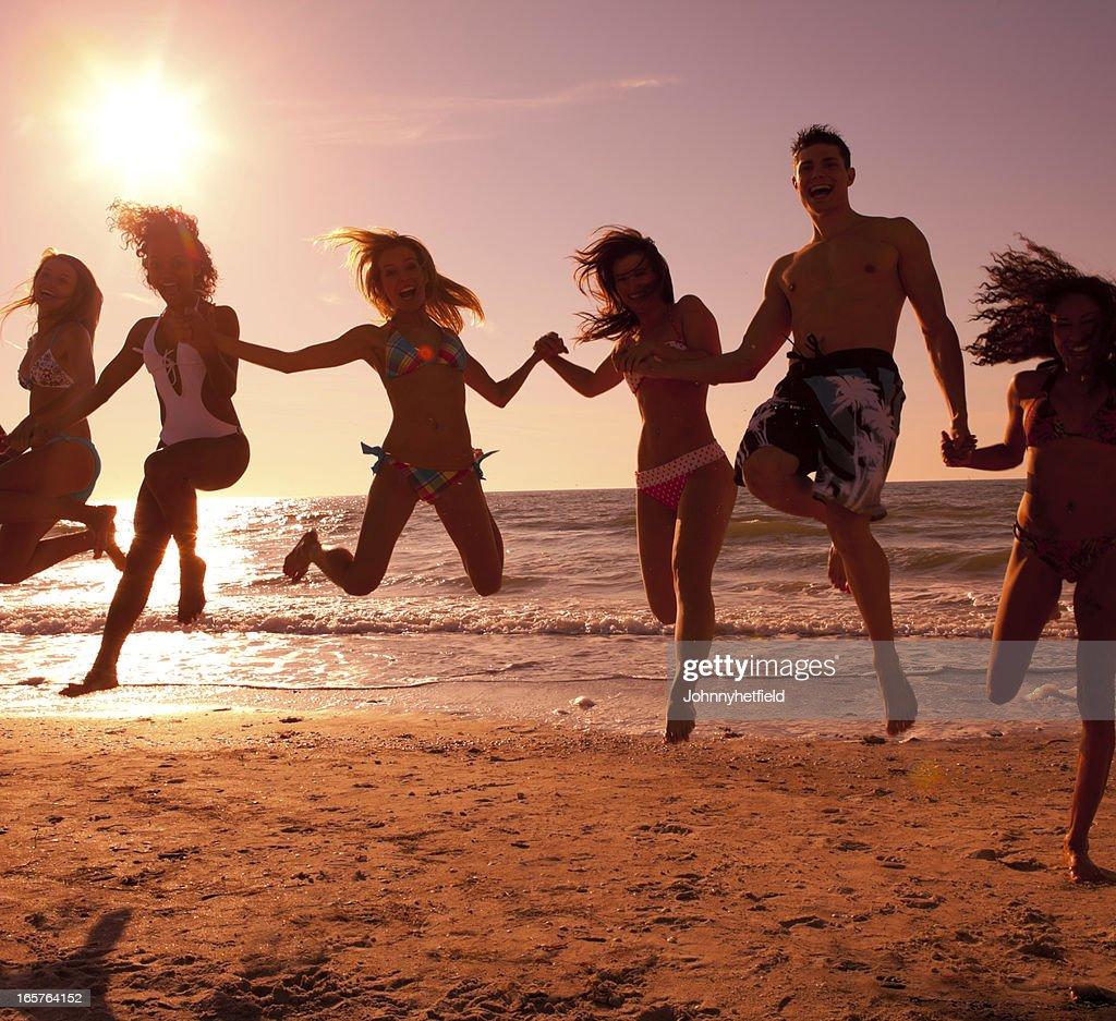 Multi ethnic friends having fun at the beach : Stock Photo