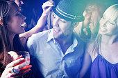 Multi ethnic people having fun in nightclub at a party