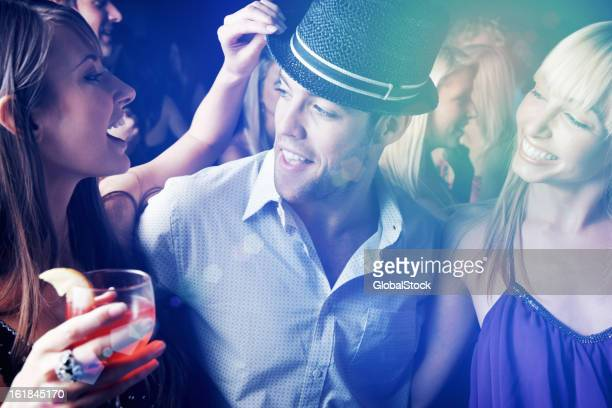 Multi ethnic people having fun in nightclub at a party
