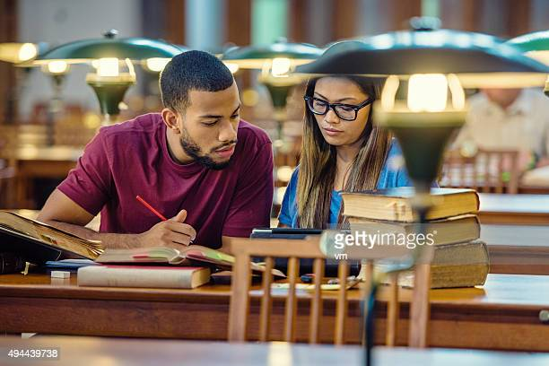 Multi ethnic  Students Studying in a Library