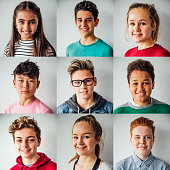 Mixed ethnic group smiling. Variation of nine teenagers of square images to make one large square portrait. Plain background