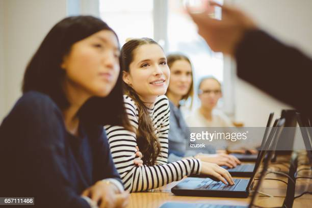 Multi ethnic young girls at computer class