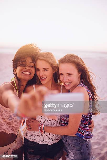 Multi ethnicl group of friends laughing for selfie