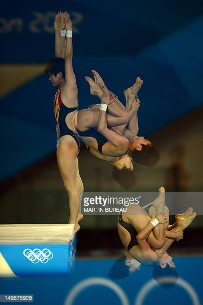 A multi exposure picture shows China's Chen Ruolin and Wang Hao compete in the women's synchronised 10m platform final at the London 2012 Olympic...