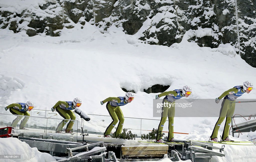 A multi exposure picture shows Czech Jan Matura compete during the FIS Ski Jumping World Cup in Vikersund, Norway on January 27, 2013.