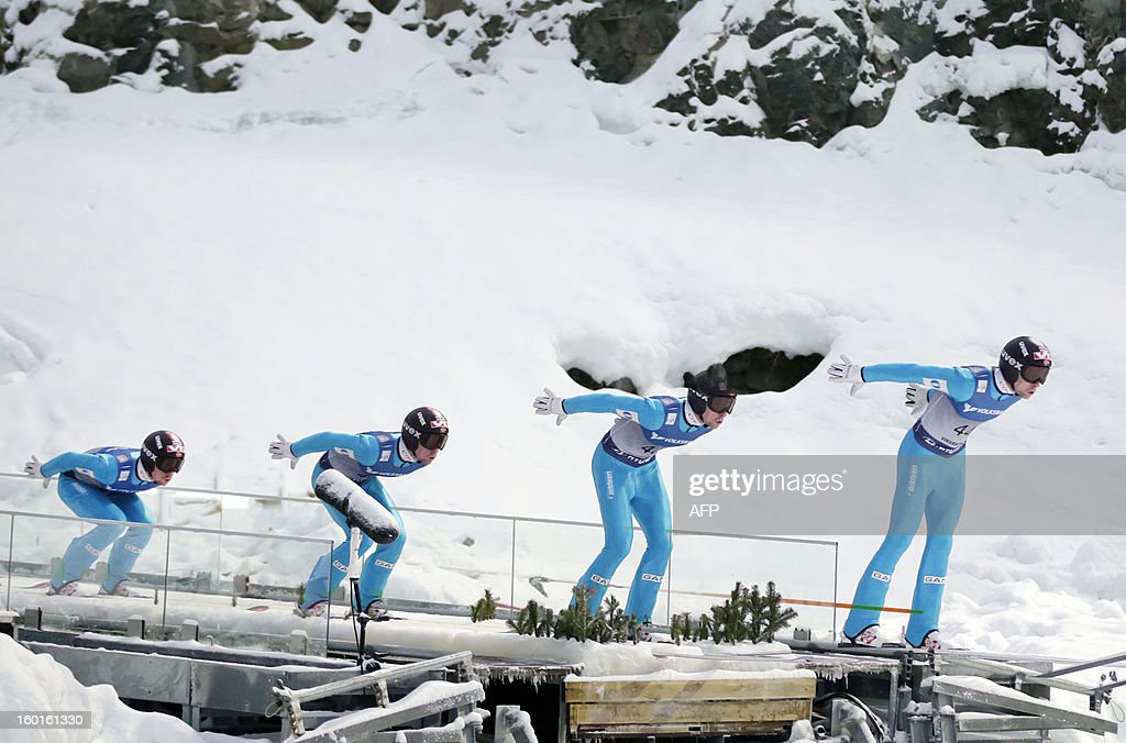 A multi exposure picture shows Norway's Anders Jacobsen compete during the FIS Ski Jumping World Cup in Vikersund, Norway on January 27, 2013.