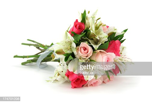 Multi flower wedding bouqet lying on side with isolated backgrou