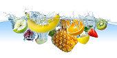 many fruits splashes into water
