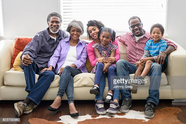 Multi generation African American family sitting together