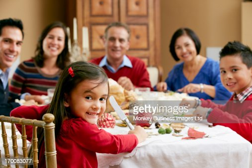 Multi Generation Family Celebrating With Christmas Meal : Stock Photo