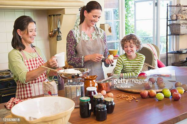 Multi generation family cooking food at kitchen