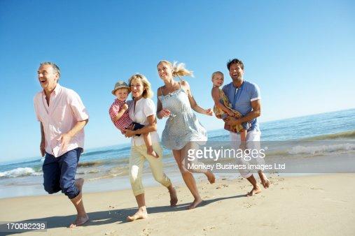 Multi Generation Family Enjoying Beach Holiday : Stock Photo