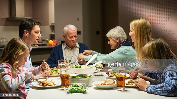 Multi generation family enjoying dinner together