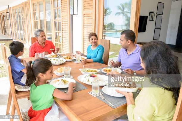 Multi generation family having dinner together