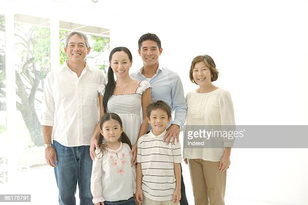 Multi generation family smiling in room
