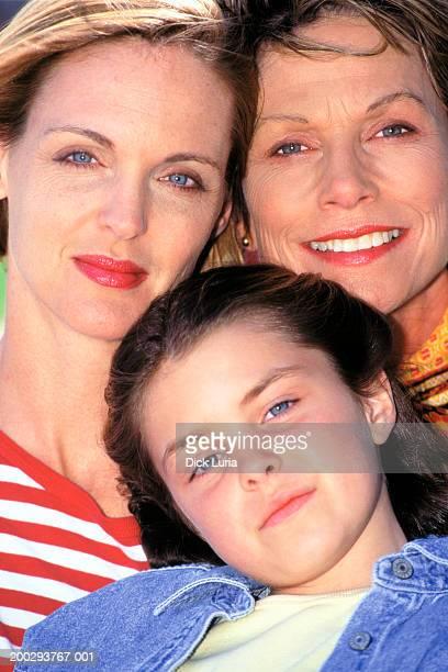 multi generational caucasian women smiling