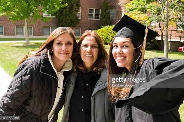 Multi Generational Family American Hispanic Women Celebrating Graduation Day USA
