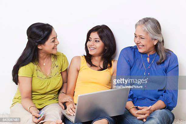 Multi generational family talking while shopping online