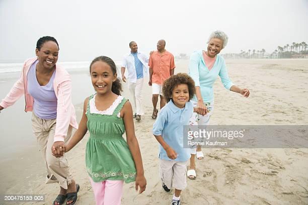 Multi generational family walking at beach
