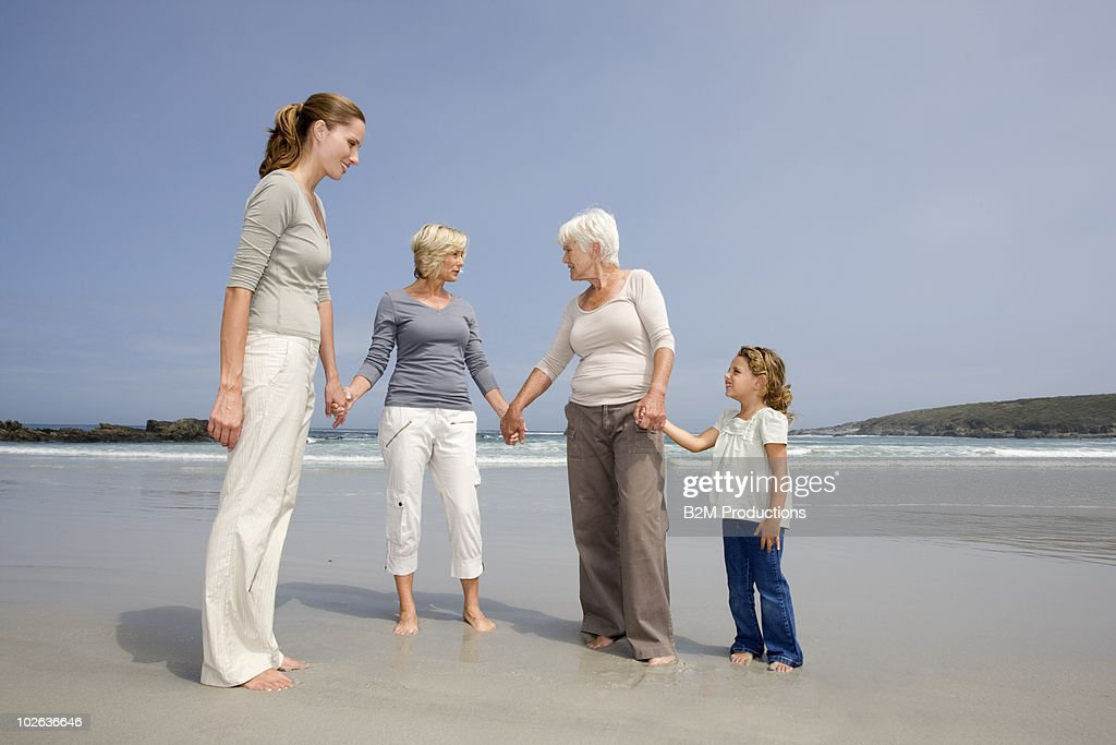 Multi generational female family at beach : Stock Photo