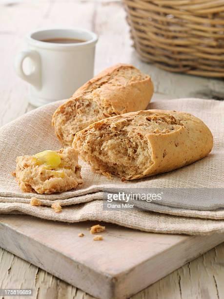 Multi grain baguette with butter on cream linen napkin