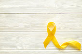 Yellow Ribbon Stock Photos and Illustrations - Royalty-Free