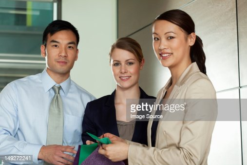 Multi racial businesspeople with colour swatches, portrait : Stock Photo