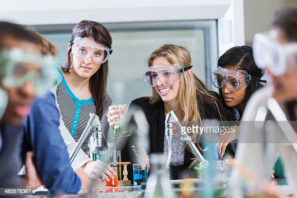 Multi racial group of students in chemistry class